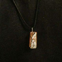 مدال نقره مذاب در چوب